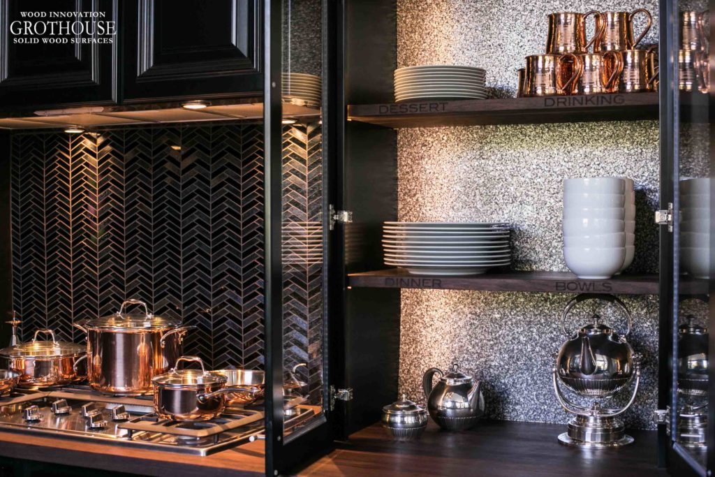 Peruvian Walnut Countertop and Shelves Complement a Wall Covered in mica shavings
