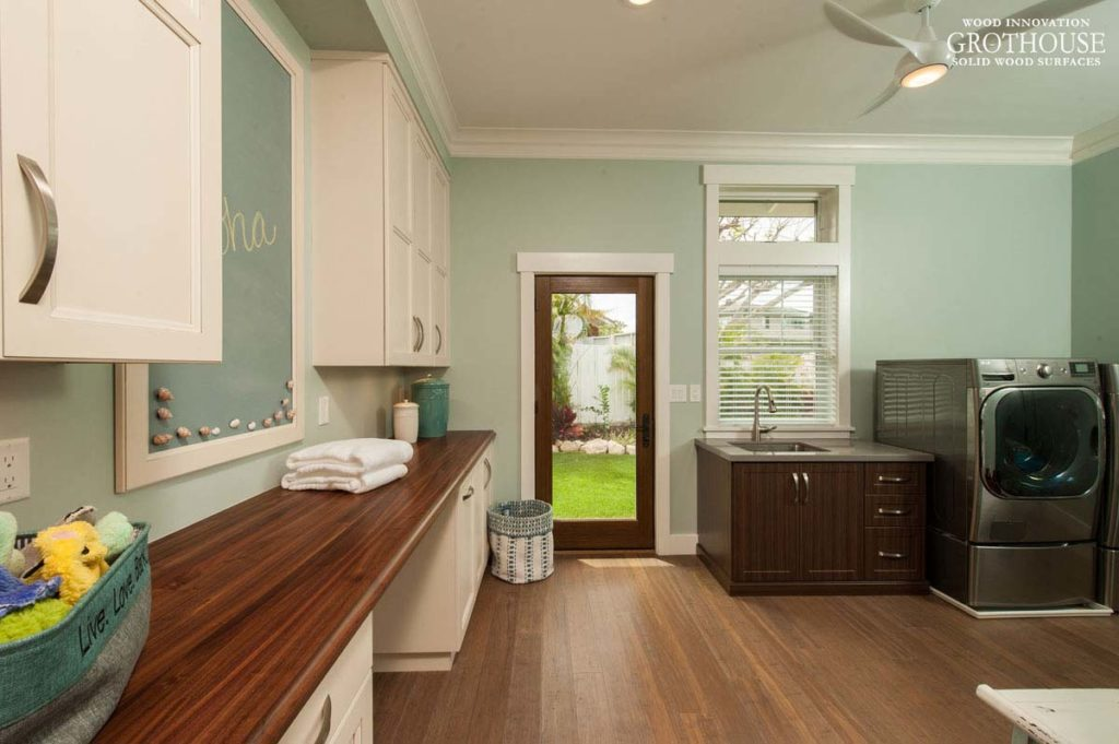 Long Wood Countertop designed for a Laundry Room runs the length of the wall