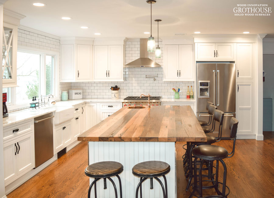 Reclaimed Chestnut Kitchen Island Countertop in a modern farmhouse kitchen designed by Coastal Cabinet Works