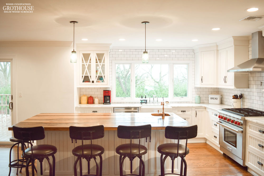 Large kitchen island with Reclaimed Chestnut countertop creates a seating area and food prep space
