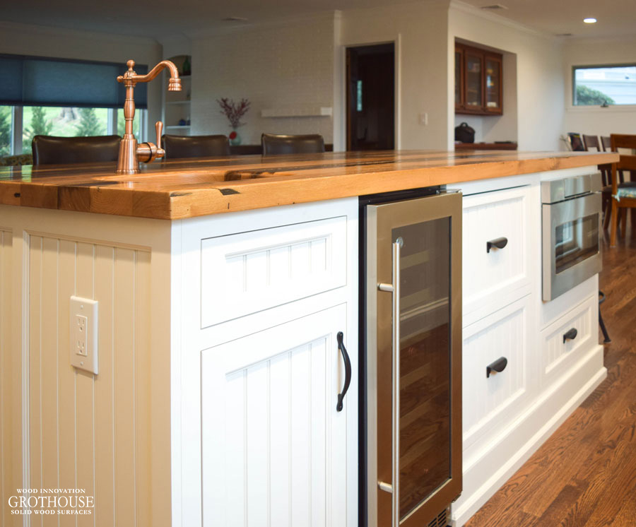 Kitchen Island with Reclaimed Chestnut Wood Countertop, sink, copper faucet, wine fridge, and microwave
