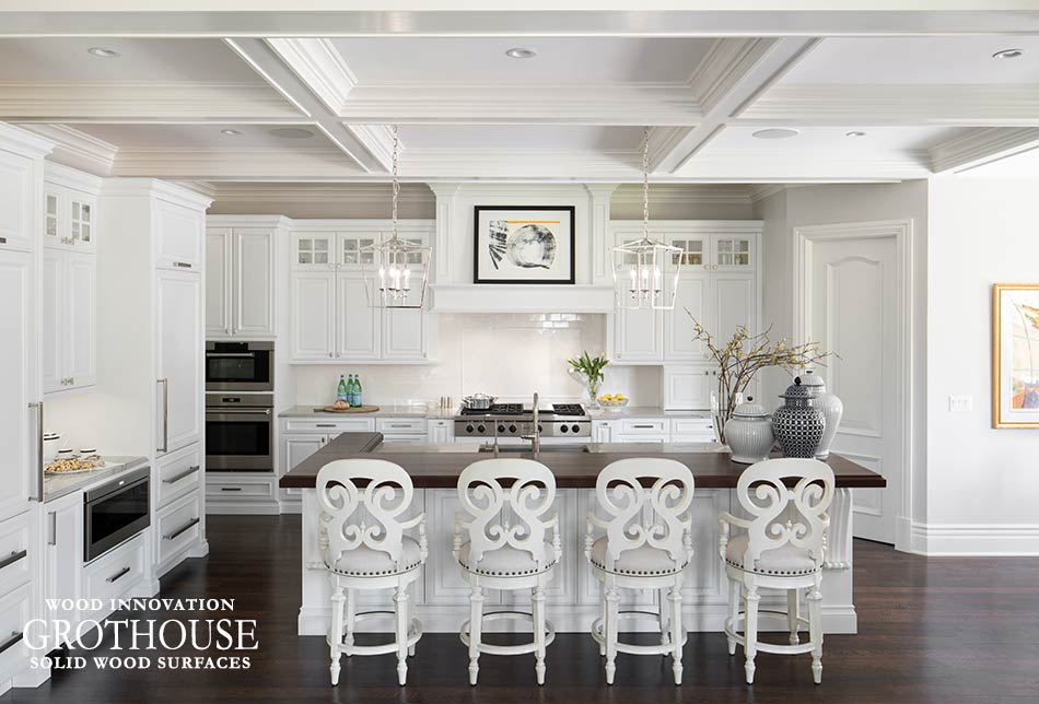 White Kitchen Design by Luxe Kitchens and Interiors includes Peruvian Walnut Bar Top