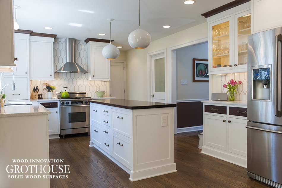 White Kitchen Design by Pine Street Carpenters Inc includes Peruvian Walnut Countertop
