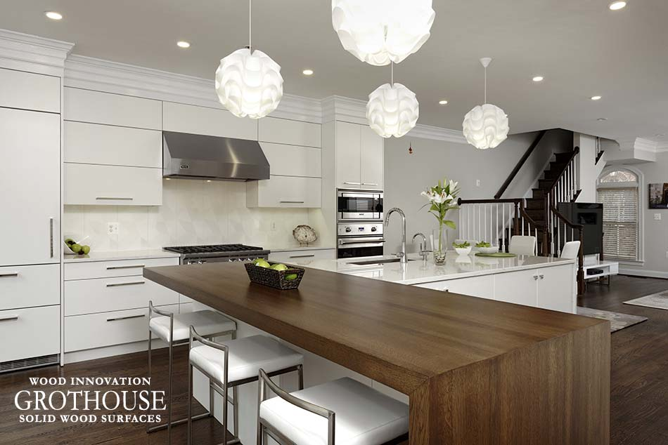 White Kitchen design by Jennifer Gilmer Kitchen and Bath includes White Oak Countertop