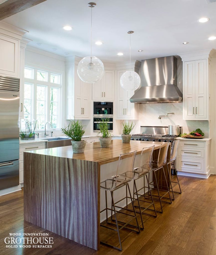 Kitchen Island Design by Karen Kassen of Kitchens Unlimited features a Waterfall Countertop