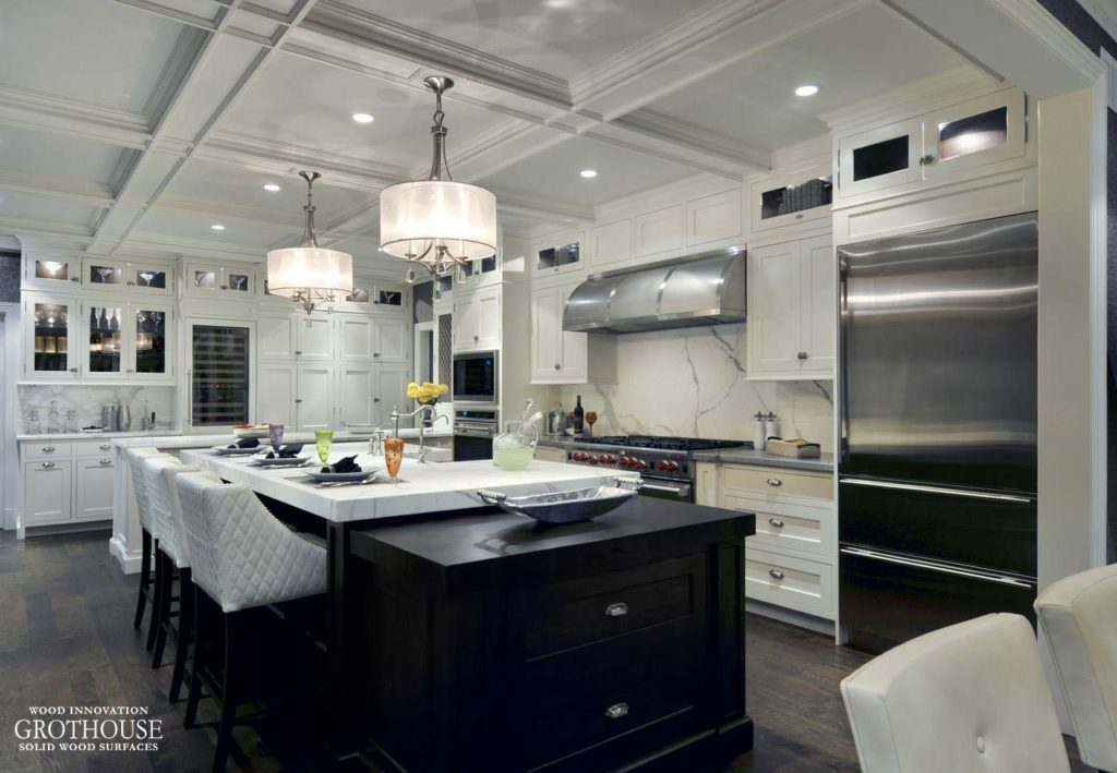 Black and White Kitchen Design by Showcase Kitchens includes a Butcher Block