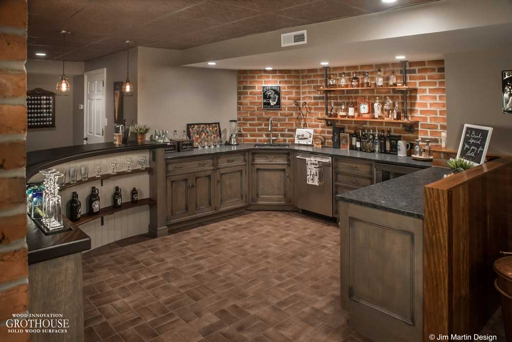 Basement bar with custom wood countertop designed by Jim Martin Design
