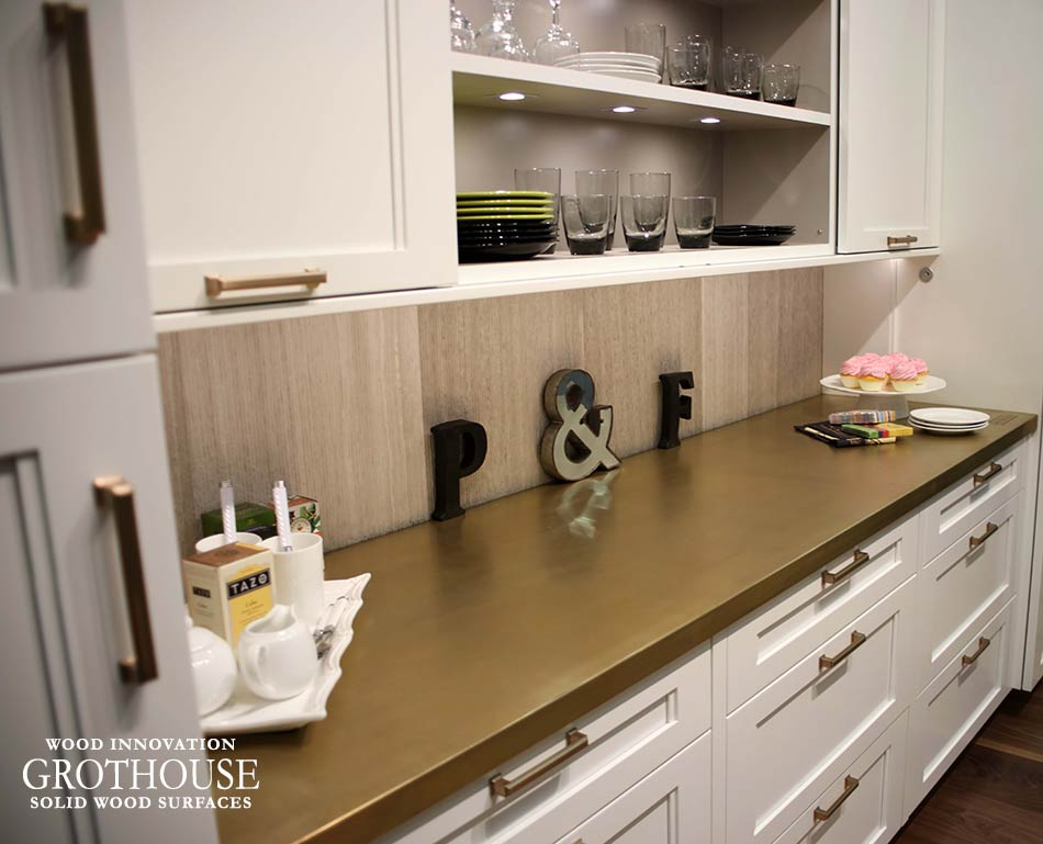 Blue Kitchen with Brass Fixtures and Anvil Magnum Metal Countertop