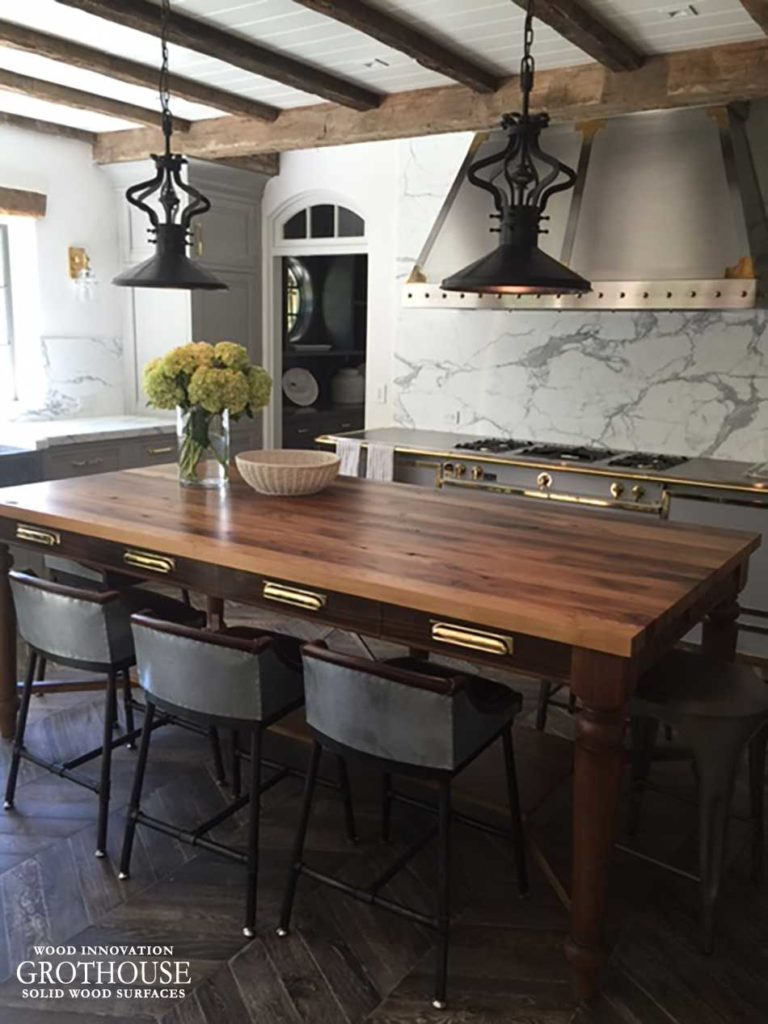 Rustic Kitchen Design with Brass Fixtures and Reclaimed Wood Table Top