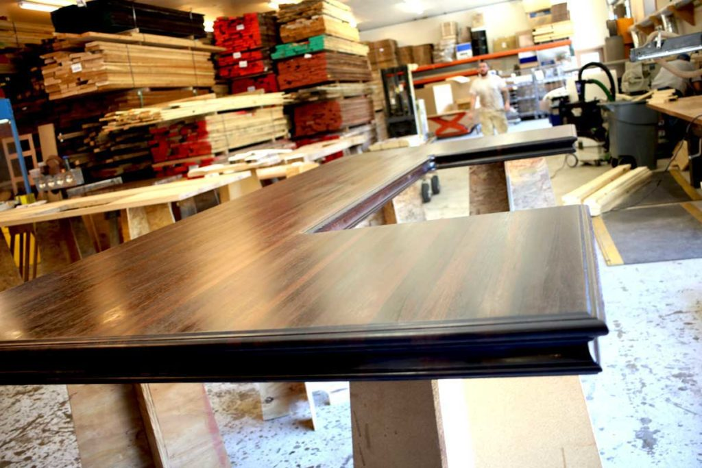Thousand pound large custom wenge wood countertop with Camelot edge profile