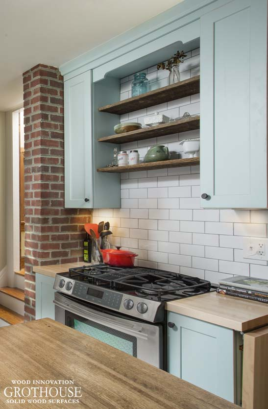 Exposed brick in kitchen design by Griffey Remodeling with Maple countertops
