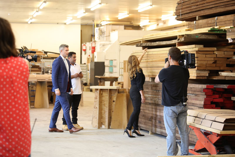 Denise Grothouse showing Ryan Serhant and Frank the different wood species used to craft cabinets.