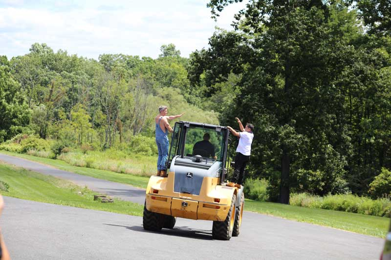 Ryan Serhant and Frank enjoy a skid loader ride from Paul Grothouse for Sell It Like Serhant Bravo TV Series
