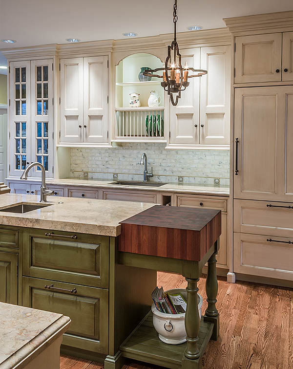Light Green Kitchen Cabinets with a wood butcher block countertop in Glennview, Illinois