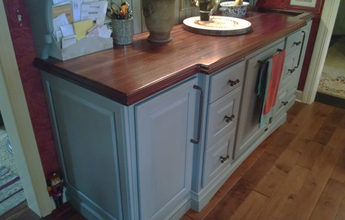 Distressed Sapele Mahogany Wood Countertop with undermount sink for blue kitchen cabinets