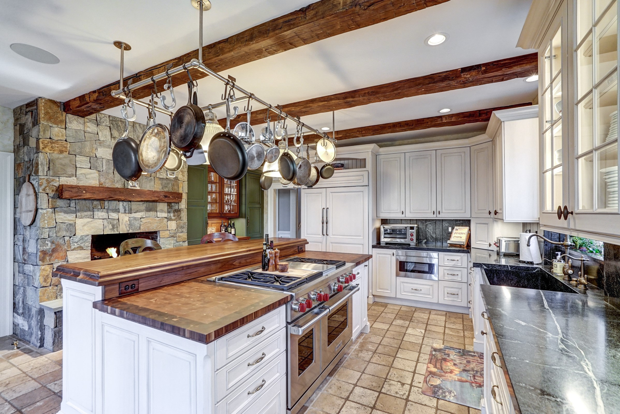 Custom Walnut Wood Backsplash Connects the Upper and Lower Levels of the Kitchen Island