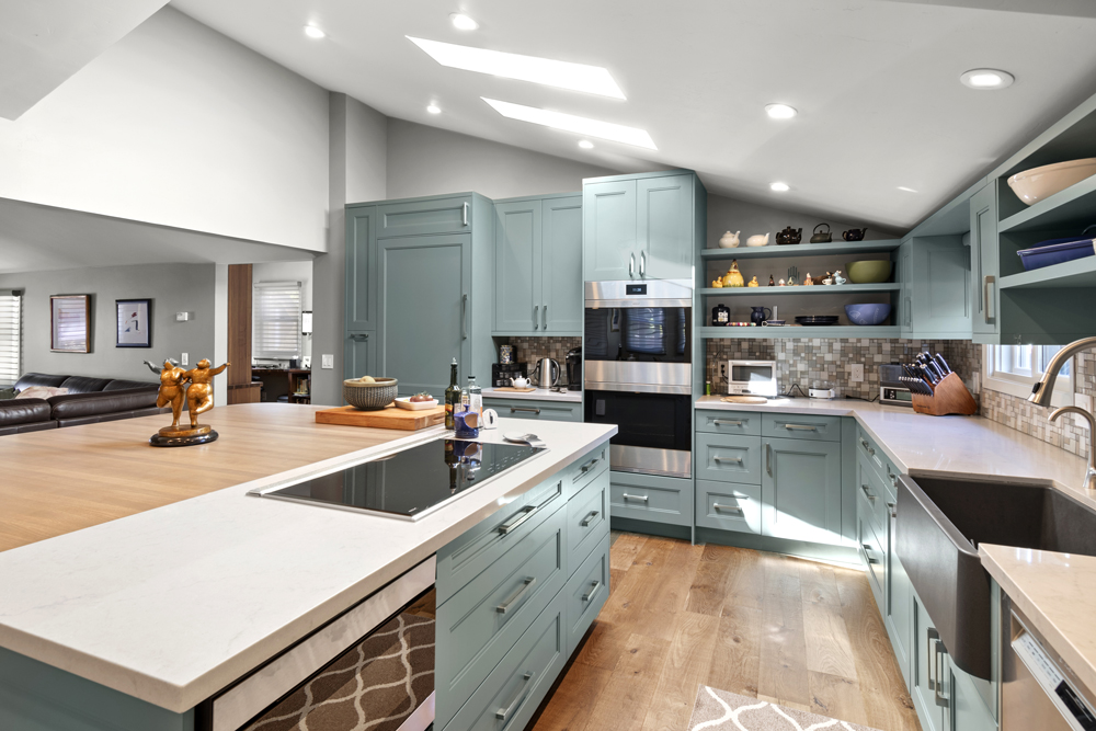 Ash Wood and Engineered Quartz Counters for a Soft Teal Kitchen