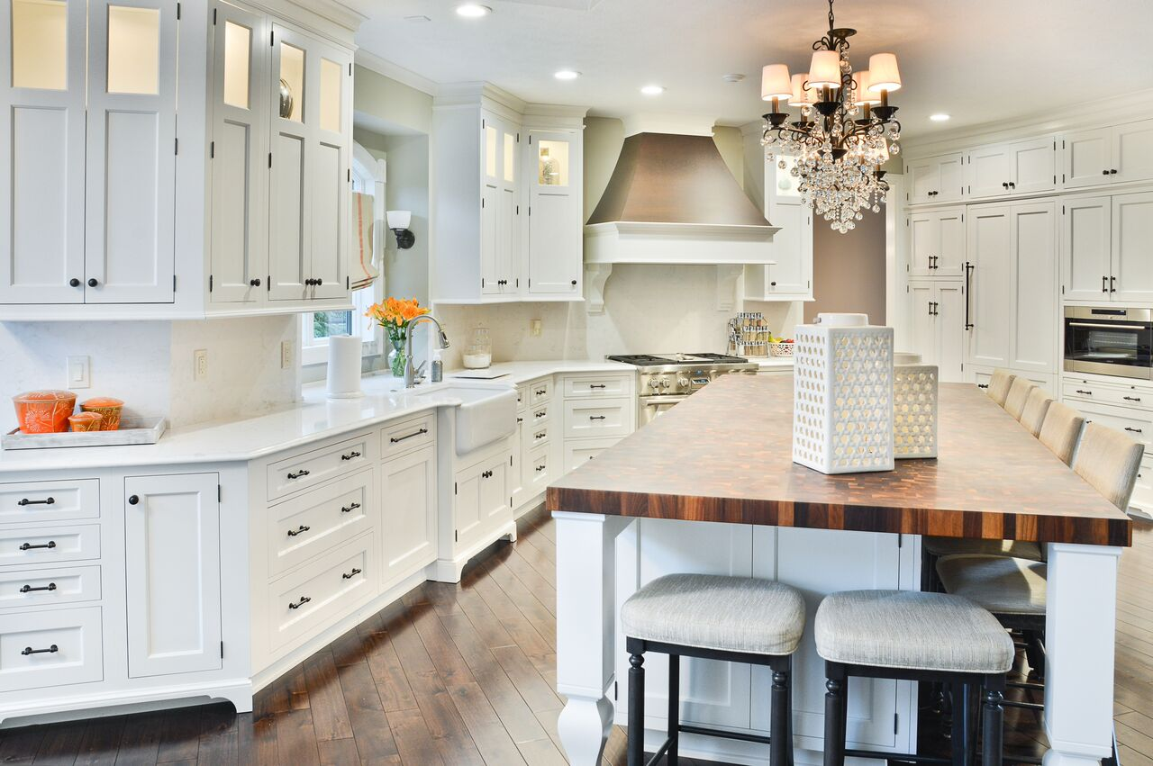 A Timeless Classic White Kitchen with a large island and butcher block countertop