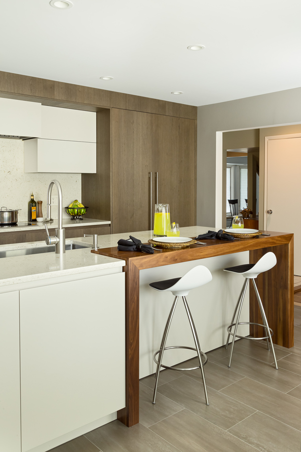 Walnut Waterfall Counter in Modern Kitchen designed by Showcase Kitchens