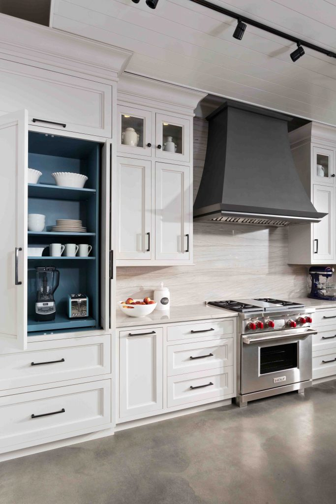 Anvil Metal Range Hood in an all white kitchen design