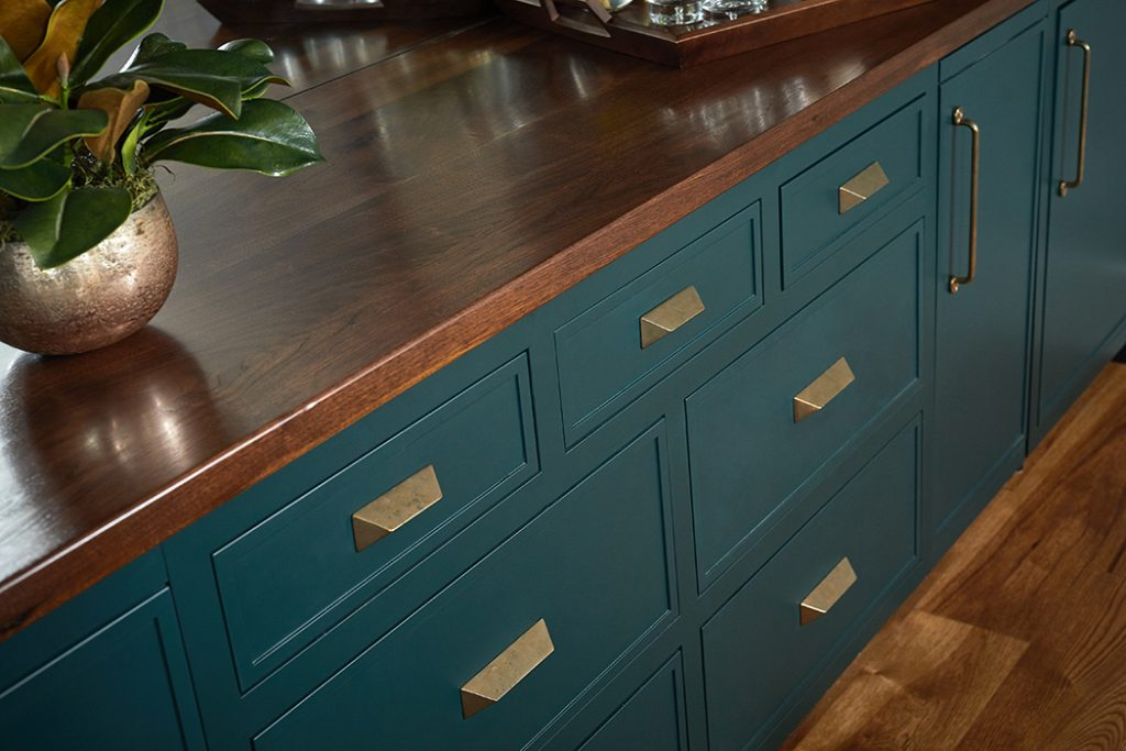 Walnut Dining Room Bar Top with Blue Cabinetry and Gold Hardware