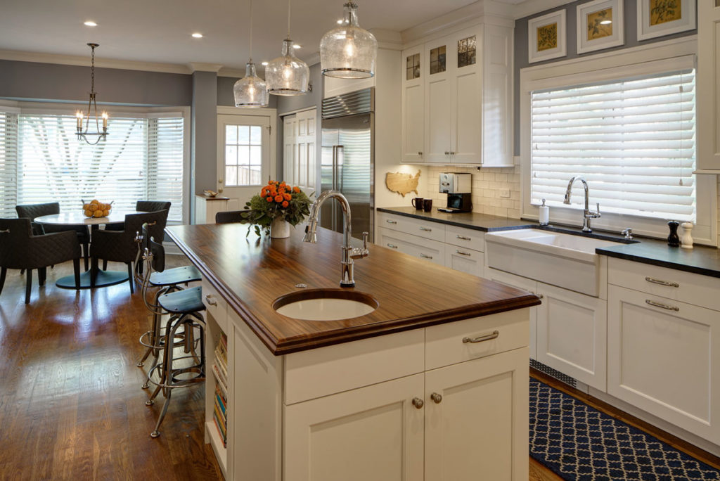 Sapele Mahogany Kitchen Island Top with a Sink designed by Drury Design Kitchen and Bath Studio