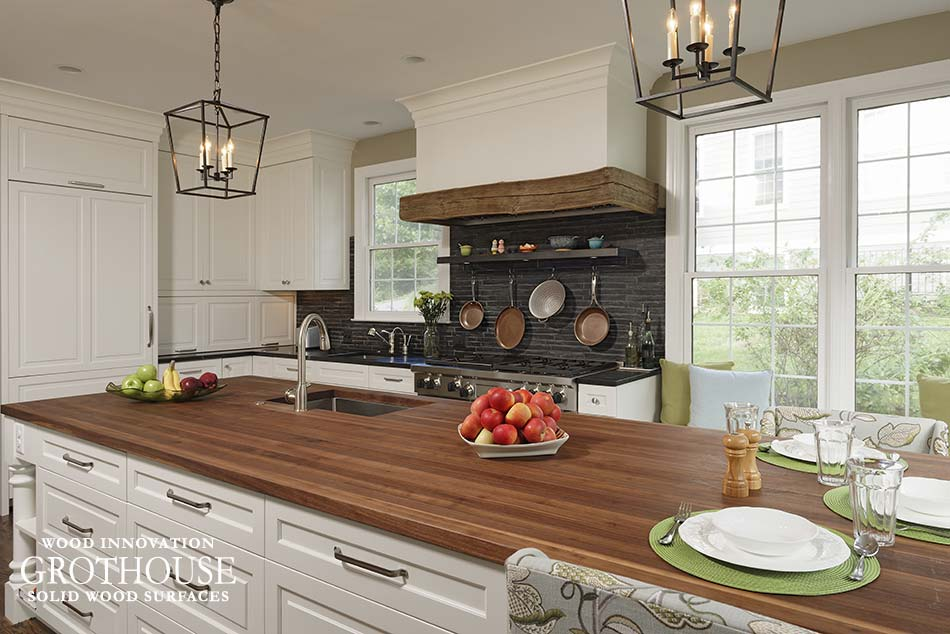 Kitchen Island with Walnut wood countertop designed by Sarah Kahn Turner of Jennifer Gilmer Kitchen & Bath