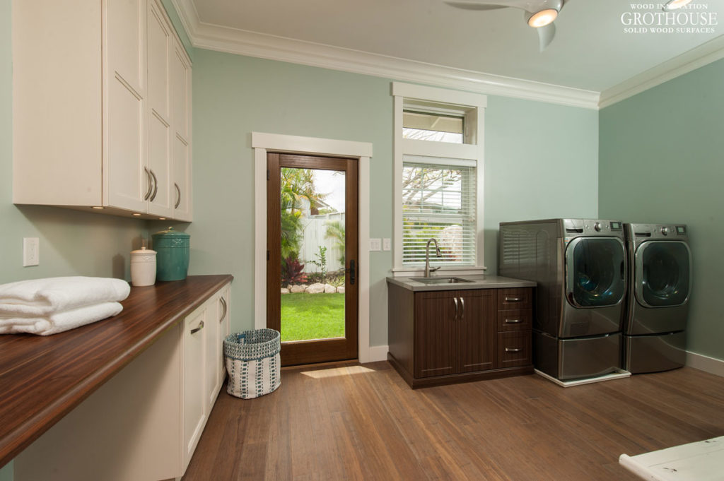 Custom Wood Countertop designed for an Ultimate Laundry Room with an expansive run of cabinetry