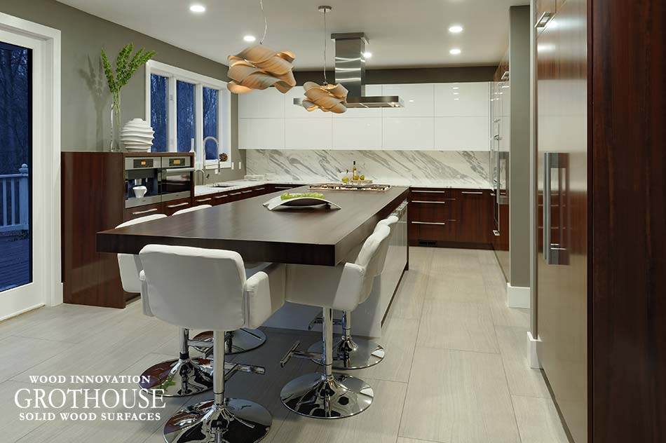 Kitchen Island Design by Paul Bentham of Jennifer Gilmer Kitchen Bath includes Wood Countertop