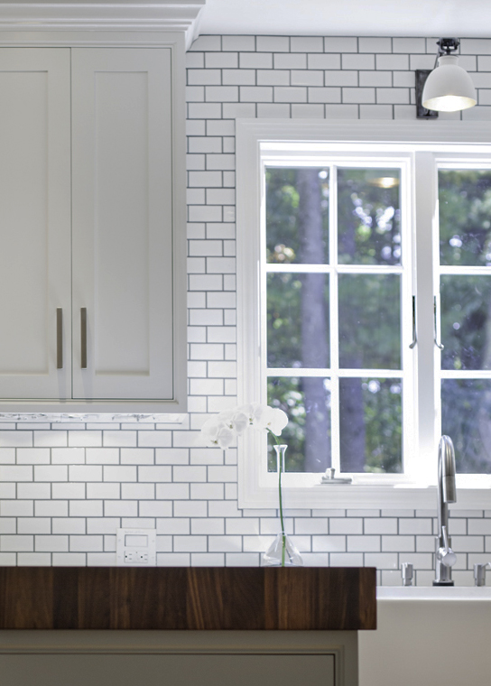 Subway Tile Backsplash with Wood Countertops and Butcher Blocks