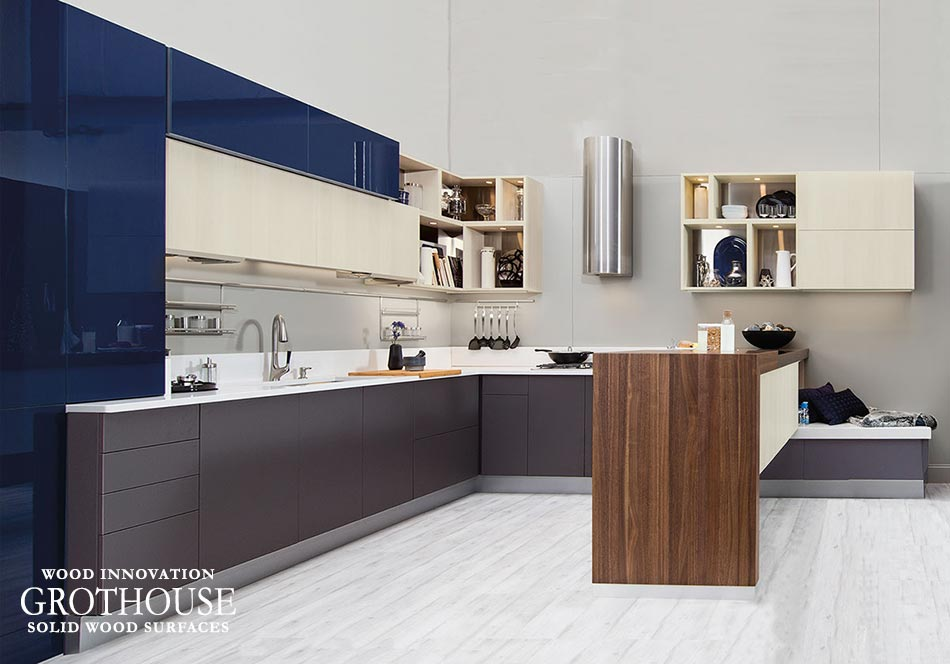Walnut Waterfall Countertop designed by Wellborn Cabinet serves as a peninsula