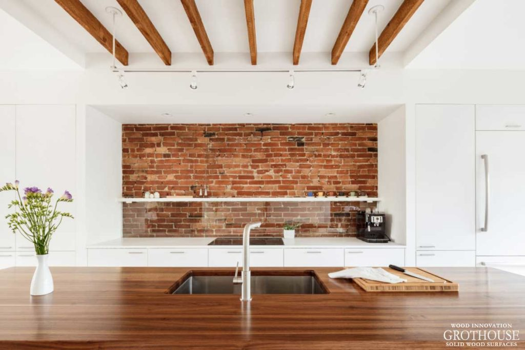 Exposed Brick Kitchen Designs with Wood Countertops custom crafted by Grothouse nationwide