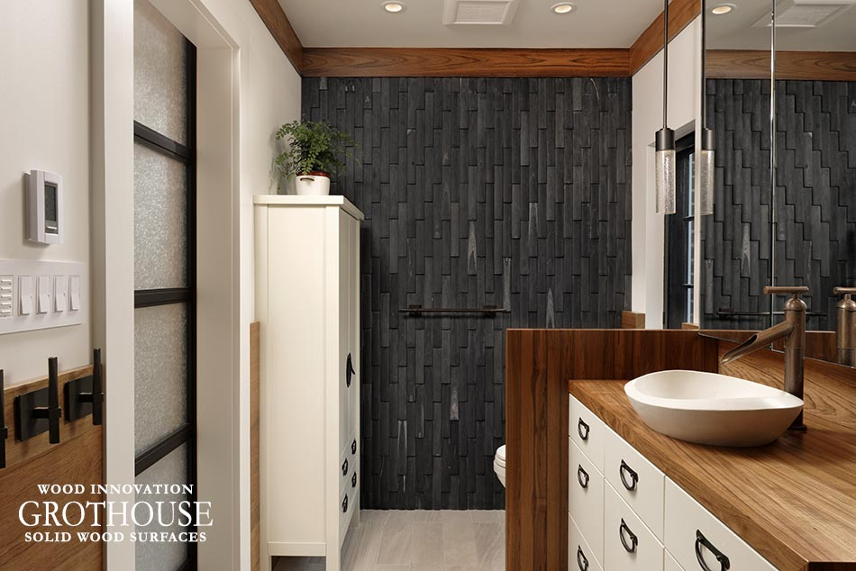 Custom wood wall niche creates a level of privacy and adds warmth to the space