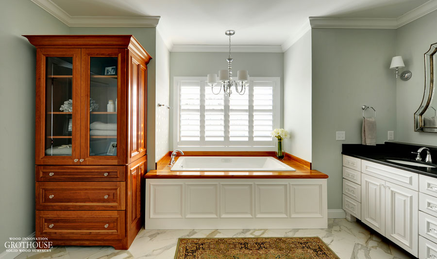 Wood Bath Surround designed for a traditional style master bathroom with white cabinetry