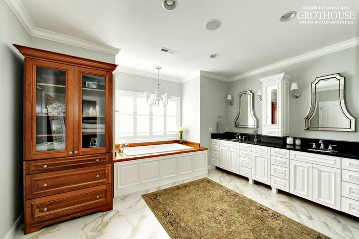 Wood Bath Surround matches hutch and complements marble floor in traditional master bath