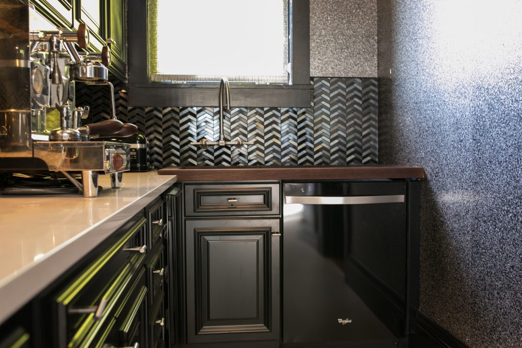 Butlers Pantry with Black Cabinets and Peruvian Walnut Wood Countertop with Drainboards