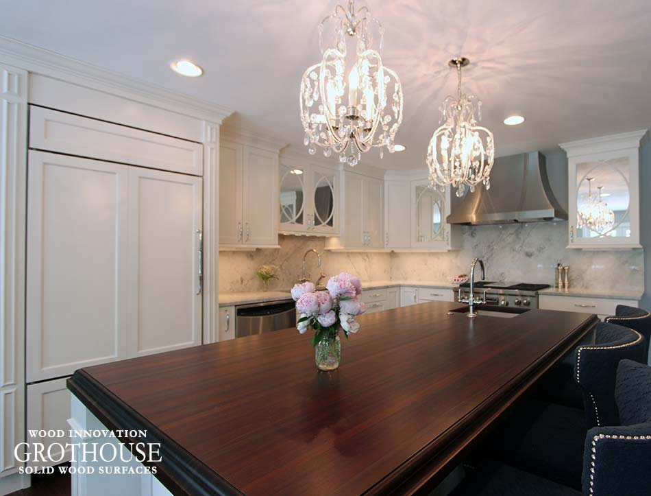 Romantic Kitchen Design by Denise Quade Design with a Peruvian Walnut Island Countertop