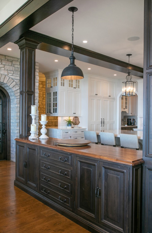 Distressed Walnut Countertop with black painted cabinetry in a transitional space