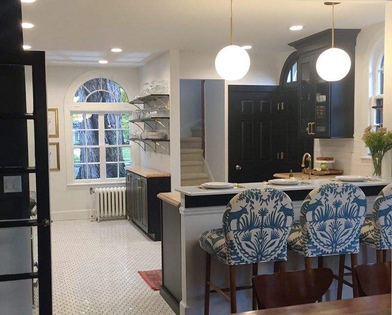 Ash Wood Countertops for black cabinets in a kitchen designed by Melissa Sauter