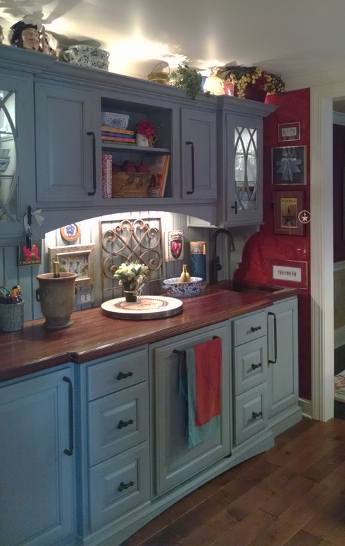 Distressed Sapele Mahogany Countertop for blue cabinets with beadboard backsplash and undermount sink