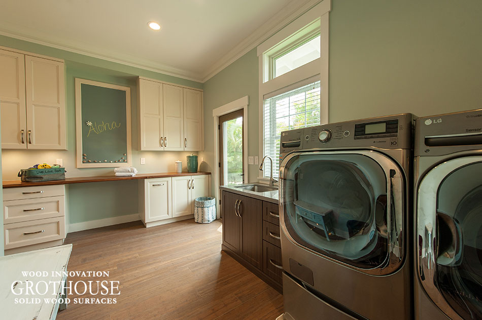 Walnut Wood Countertops for Laundry Rooms with White Cabinetry and Wood Flooring
