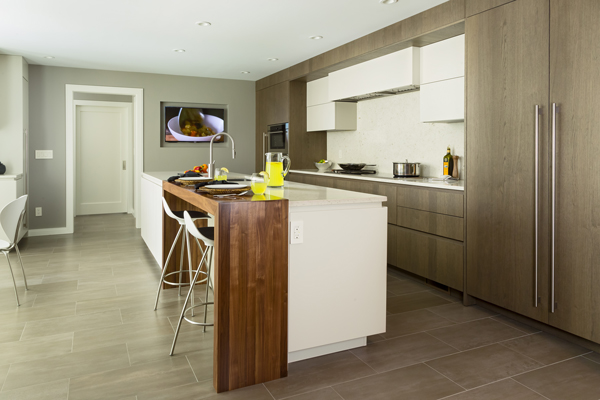 Modern Kitchen with Walnut Waterfall Counter designed by Showcase Kitchens