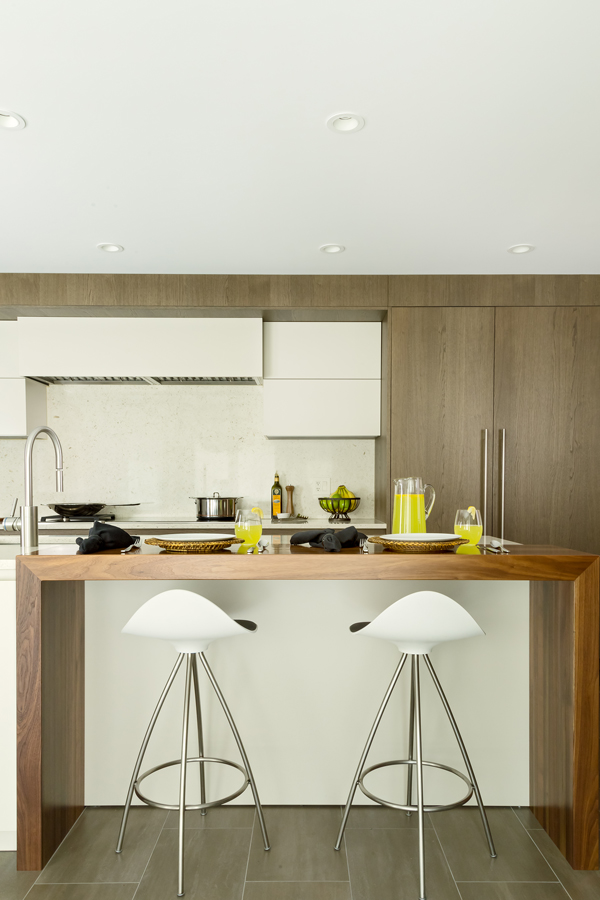 Walnut Wood Waterfall Counter in Modern Kitchen designed by Showcase Kitchens
