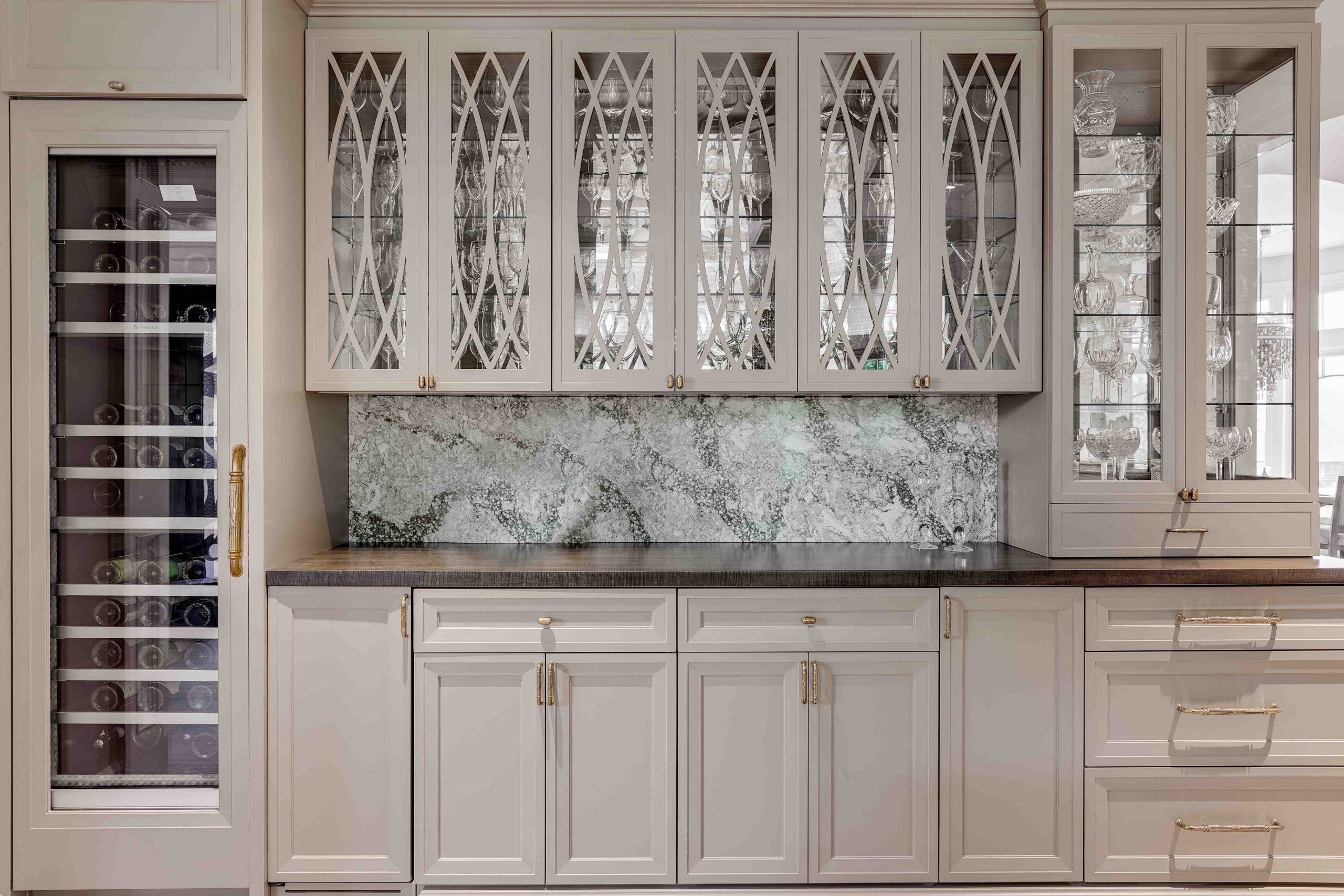 Wet Bar with Glass Front Cabinet Doors and Stained Wood Top