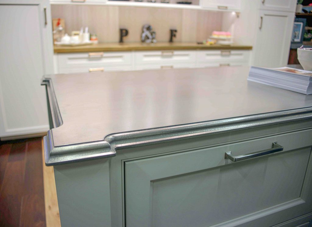 Expanded Corners on Pewter Metal Finished Countertop for a Kitchen Island