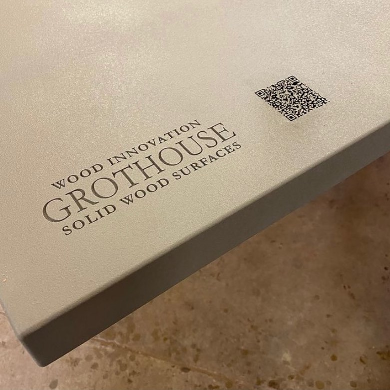 Laser Engraved Anvil Metal Countertops can include company logos and QR Codes